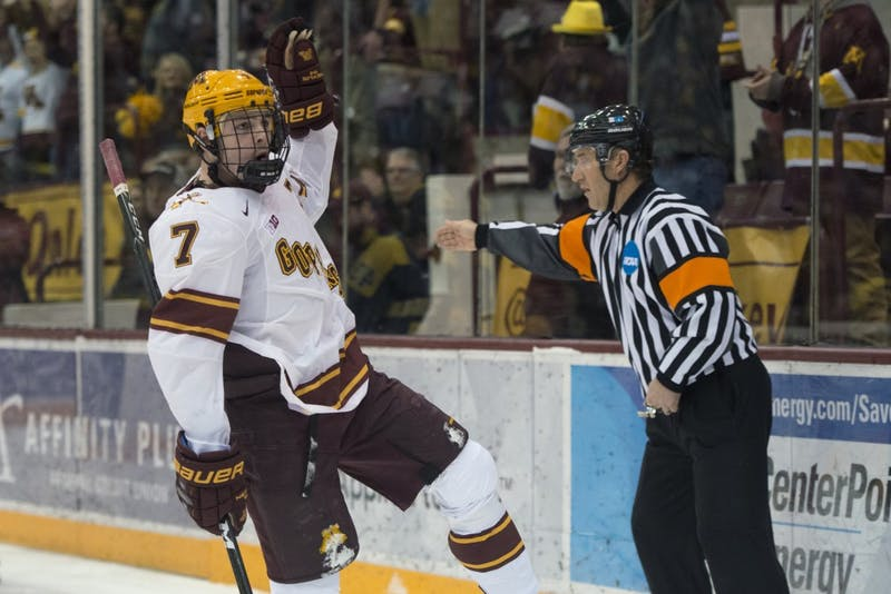 Freshman forward Brannon McManus celebrates after scoring his goal late in the third period against Michigan on Friday.