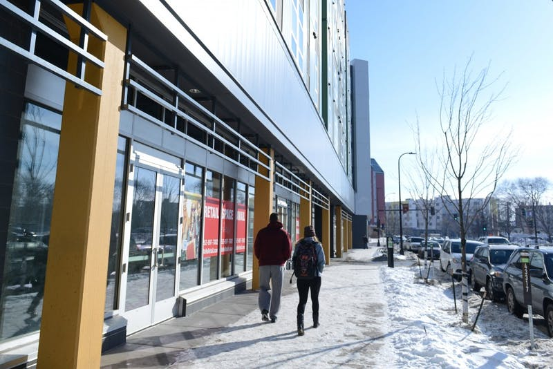 Students walk past the spot where Lao Sze Chaun, a Chicago-based Chinese restaurant chain, will be opening a location below WaHu in early February. The restaurant will be an addition to a collection of established Chinese restaurants in the Stadium Village area.