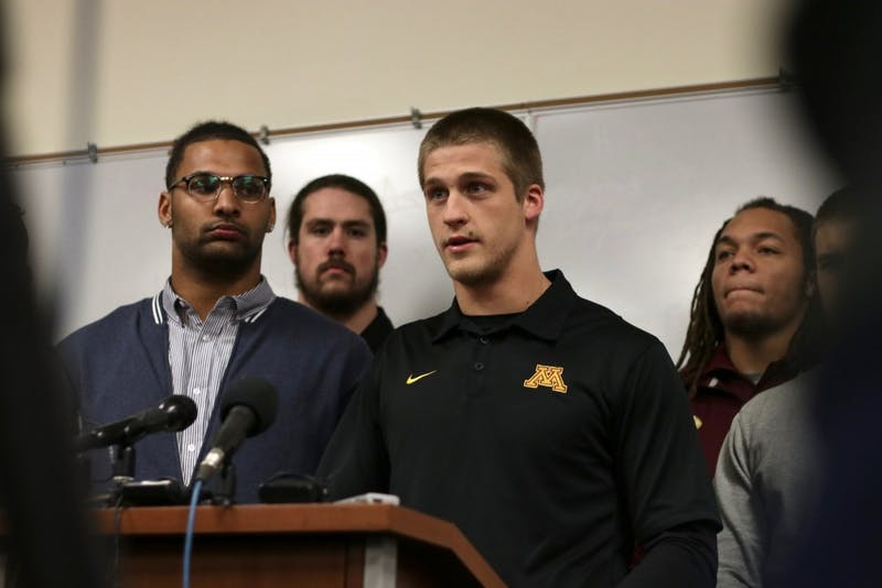 Senior wide receiver Drew Wolitarsky, right, addresses reporters at a news conference, announcing the end of the Gophers football team's boycott on Saturday, Dec. 17, 2016. The team boycotted after 10 players were suspended in relation to a Sept. 2 alleged sexual assault.