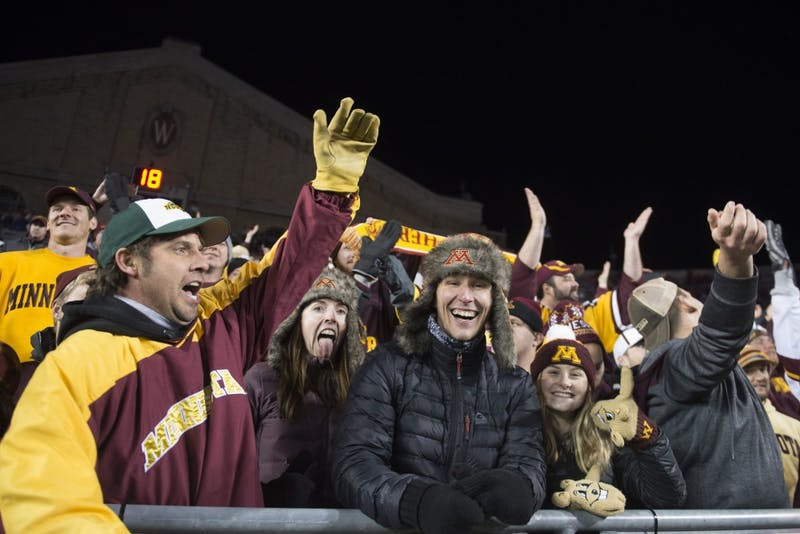 Gopher fans appeared in droves in the front row as Badger fans left at Camp Randall Stadium in Madison on Saturday, Nov. 24. The Gophers beat the Badgers 37-15 for the first time since 2003.