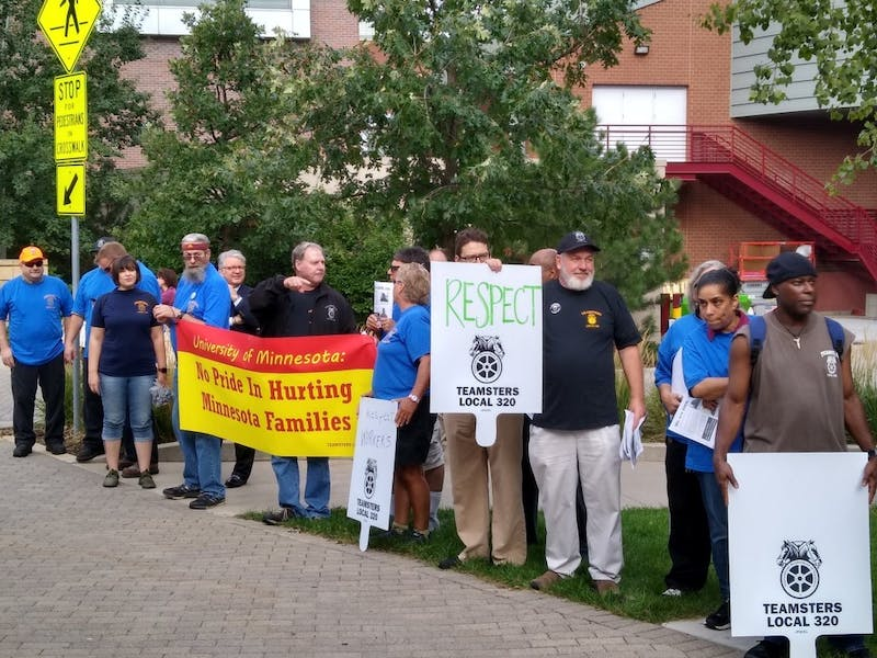 Union members demonstrate at President Joan Gabel's inauguration on Friday, Sept. 20.