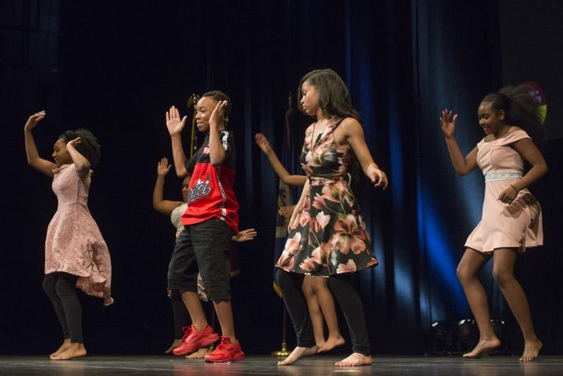 Graduating eighth graders from Northeast Middle School in Minneapolis perform a dance during the ceremony on Thursday, June 7 at Northrup Auditorium.