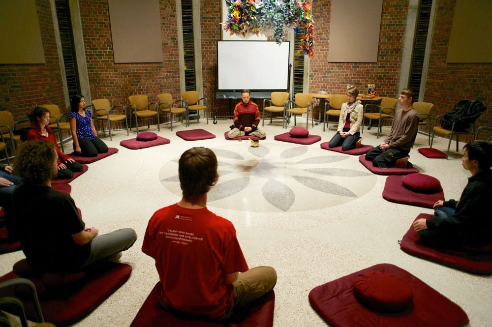 Students meditate to relieve stress