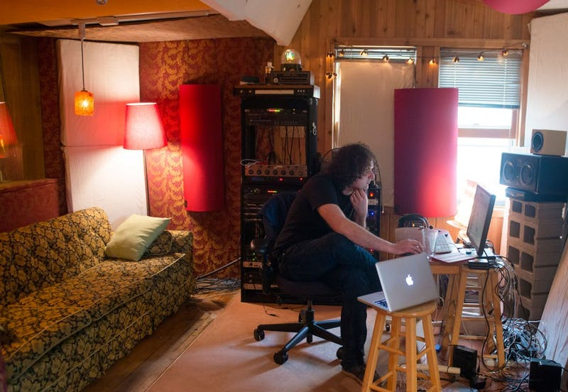 Minneapolis-based sound engineer Neil Weir finishes up work on the upcoming Chambermaids album in the control room of Old Blackberry Way studio on May 6, 2015.