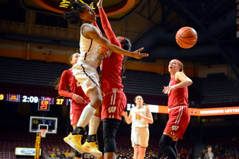 Gophers women's basketball player Kenisha Bell loses control of the ball during the game against Wisconsin on Thursday, Jan. 18 at Williams Arena.