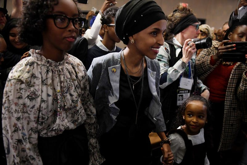 Ilhan Omar enters her election party with her family on Tuesday, Nov. 6 in Minneapolis.