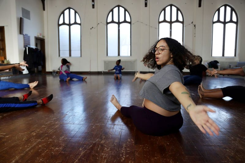 "Alicia Jameel dances at a session called ""Finding Your Divinity"" on Sunday Feb. 25 in Minneapolis. The session was hosted by BLAQ Art Director Deja Stowers. BLAQ uses artistic form to reflect the Black experience with the goal of social change."