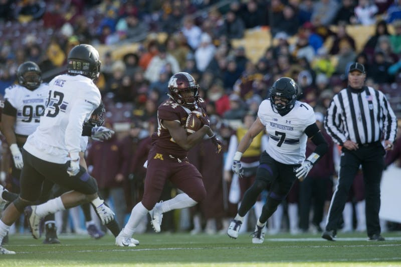 Running back Mohamed Ibrahim carries the ball on Saturday, Nov. 17 at TCF Bank Stadium.