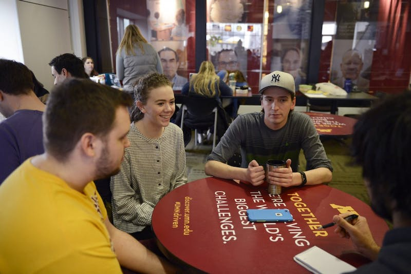 Wes Leksell, Katie Kaseno, and Hunter Welch, members of the University curling club, talk about recently wining an national champion Coffman Union on Eastbank on Friday, March 24, 2017.