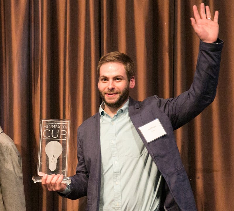 Former Apple engineer Matt Ronge accepts his trophy after winning the grand prize of $50,000 for his start-up company Astropad. The MN Cup Final Awards Ceremony was held at McNamara Alumni Center on Wednesday.