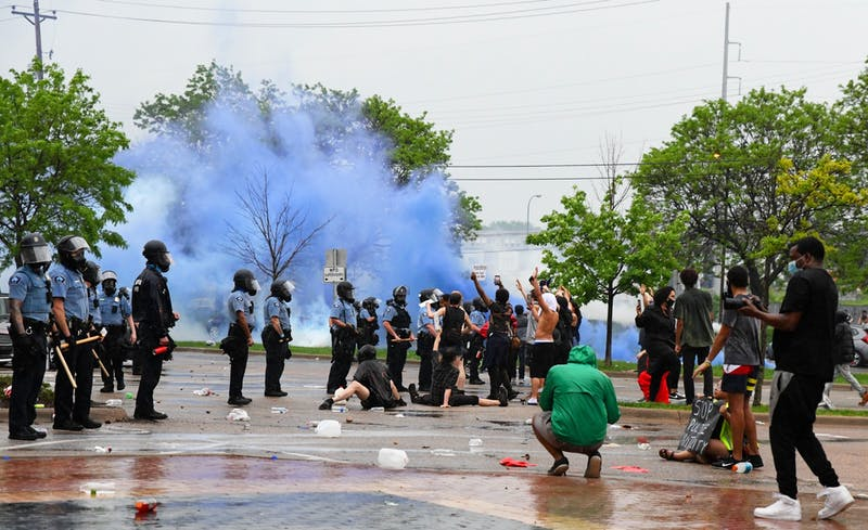 Protesters clash with police outside of the Minneapolis 3rd Police Precinct on Minnehaha Ave on Tuesday, May 26. The protest was in response to the death of George Floyd in police custody. (Andy Kosier / Minnesota Daily)