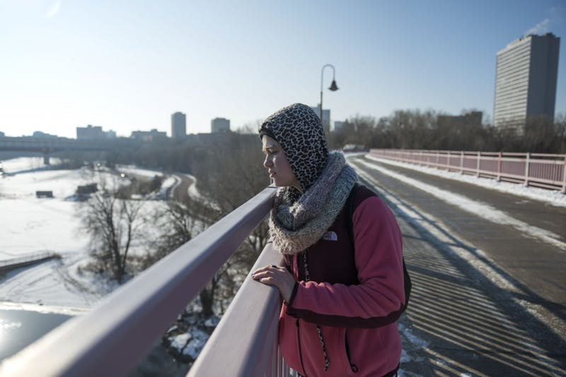 Gila Grad, a student studying gender and women's studies, religious studies, and Jewish studies, poses for a portrait on a bridge on the East Bank campus on Sunday, Dec. 9. Grad survived a suicide attempt over a year ago.