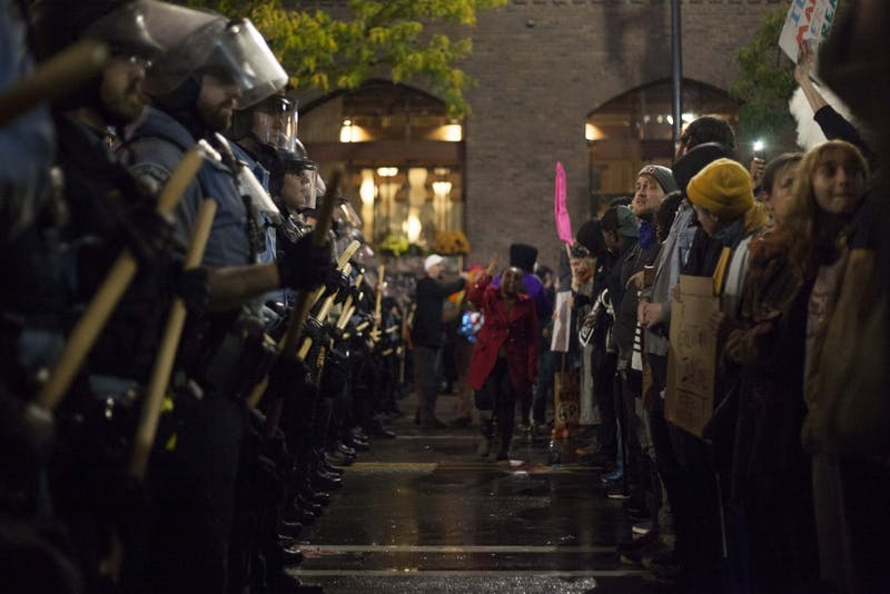 Protestors and police confront each other outside of the Target Center on Thursday, Oct. 10.