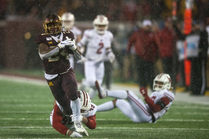Running back Mohamed Ibrahim runs the ball during the Gopher game against the Badgers at TCF Bank Stadium on Saturday, Nov. 30.