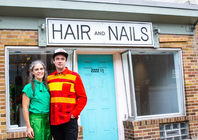 Kristin Van Loon, left, and Ryan Fontaine, owners and operators of Hair + Nails Contemporary Art Gallery, pose for a portrait in front of the gallery in Minneapolis on Monday, July 20. The gallery, located on East 35th St., has a new exhibit about queer love opening on Saturday, July 25.