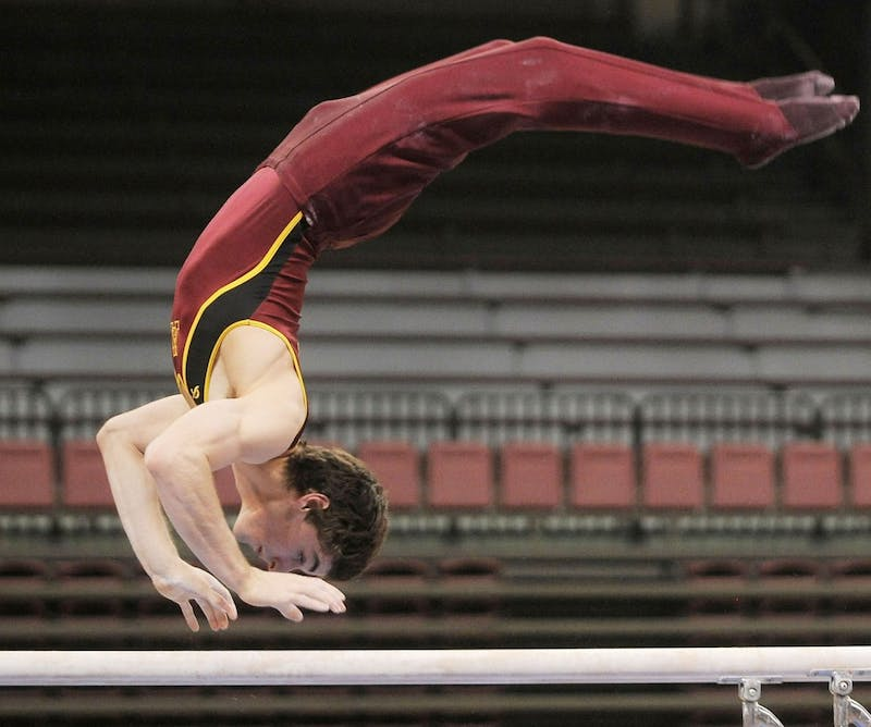 Minnesota sophomore gymnast Ellis Mannon performs his parallel bars routine Saturday, March 2, 2013, at the Sports Pavilion.