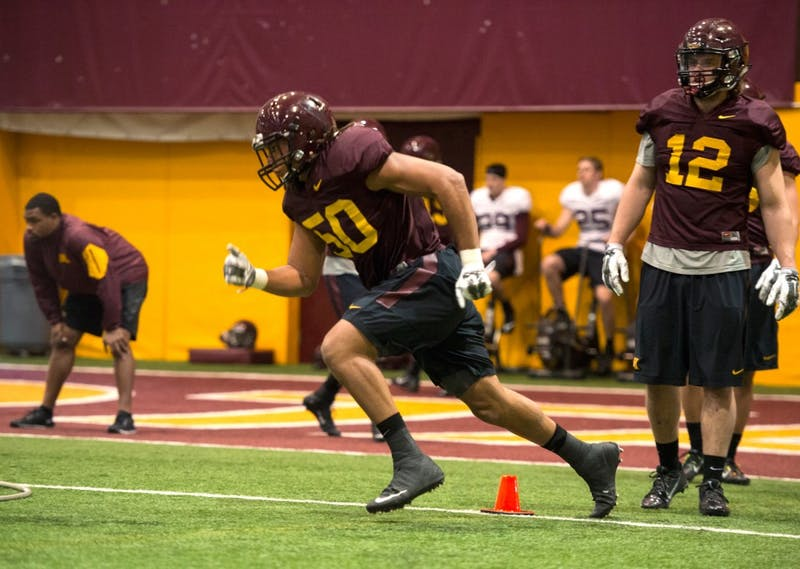 Linebacker Jack Lynn runs a drill during the Gopher's spring practice on Thursday afternoon.