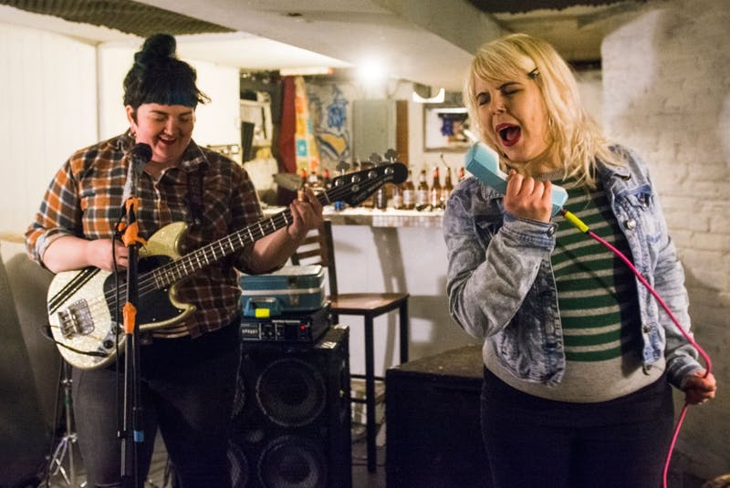 Kitten Forever singer Laura Larson and guitarist Liz Elton rehearse on Sunday in Uptown. With Corrie Harrigan, the three make up the riot-girl punk band. Their next show is at Dinkytown's Kitty Cat Klub on Tuesday.
