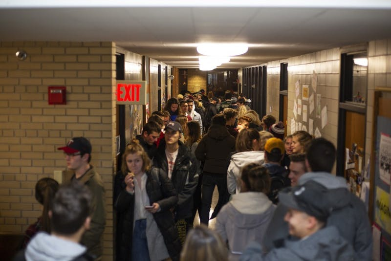 Students wait in line that wraps around the inside of the University Lutheran Church polling place on Tuesday, Nov. 6 in Dinkytown. Students said the wait was as long as two hours.