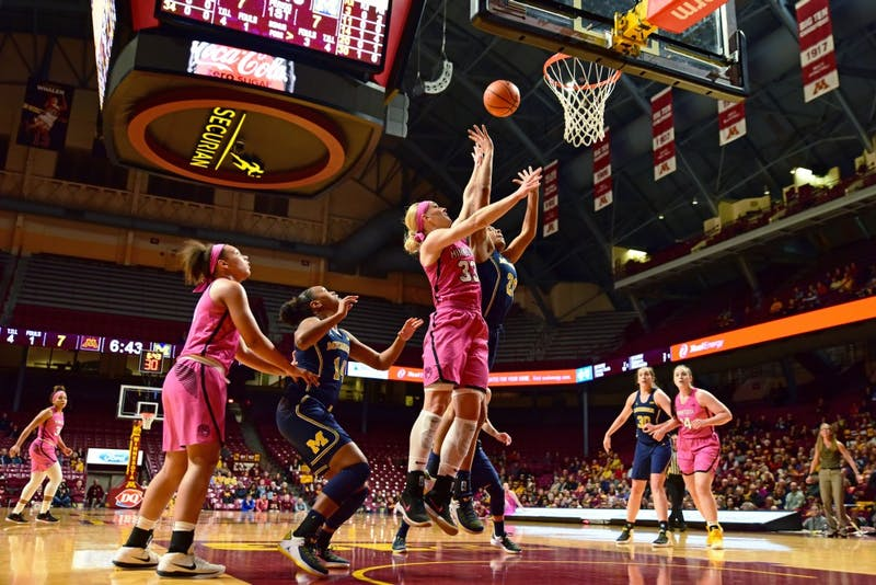 Gophers guard Carlie Wagner goes up for a shot during Minnesota's game against Michigan on Wednesday, Feb. 14. at Williams Arena.