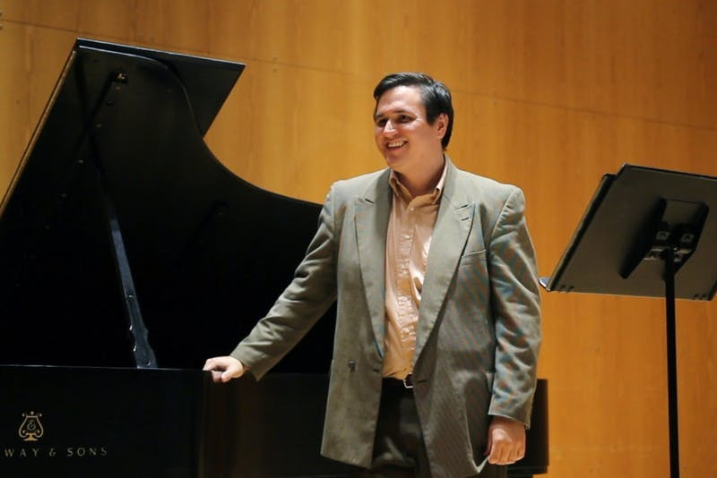 Graduate student Mario Perez receives instruction from special guest Thomas Muraco in the Lloyd Ultan Recital Hall on West Bank on Monday, Oct. 2.