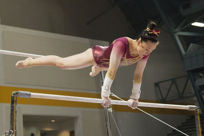 Junior Ivy Lu performs on the uneven bars on Saturday, Feb. 2 at Maturi Pavilion.
