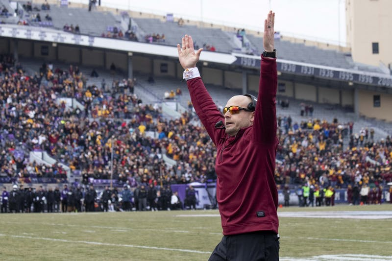 Head Coach P.J. Fleck signals a touchdown at Ryan Field during the game against the Northwestern Wildcats on Saturday, Nov. 23. The Gophers earned a 38-22 victory bringing their record to 10-1.