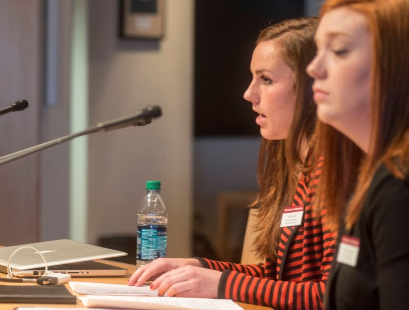 Chair and vice chair of the Student Representatives to the Board of Regents Hannah Keil and Callie Livengood present their report to the board at McNamara Alumni Center on Friday morning.