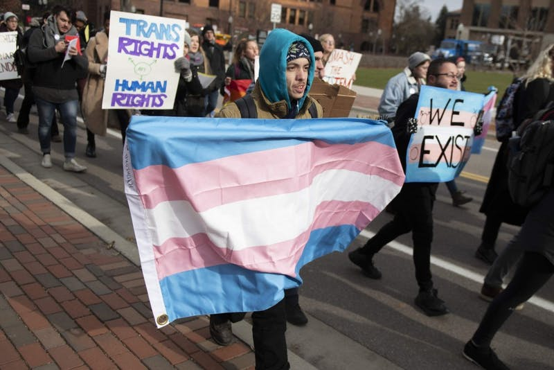 Daniel Palmer marches across the University of Minnesota campus with a transgender flag on Thursday, Nov. 8. Members and allies of the transgender community marched across campus in support of transgender rights.