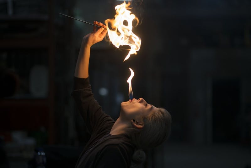"Brooke Lozano practices the ""dragon's breath"" trick during a fire breathing lesson at the Minneapolis Fire Collective on Friday, March 8."