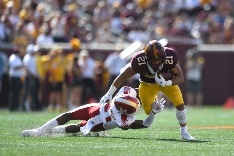 Freshman Bryce Williams avoids a tackle on Saturday, Sept. 15 at TCF Bank Stadium in Minneapolis.