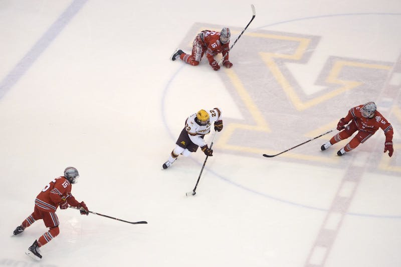 Forward Tyler Sheehy keeps the puck from Ohio State during the second period at 3M Arena at Mariucci on Friday, Feb. 16.