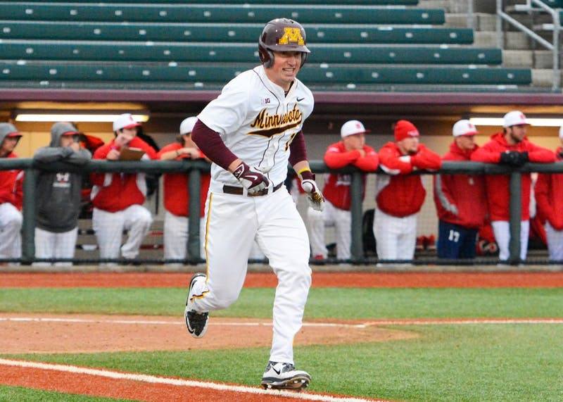 Gophers catcher Austin Athmann runs to first base after hitting a home run at Siebert Field where the Gophers played against Saint Mary's on Wednesday afternoon.
