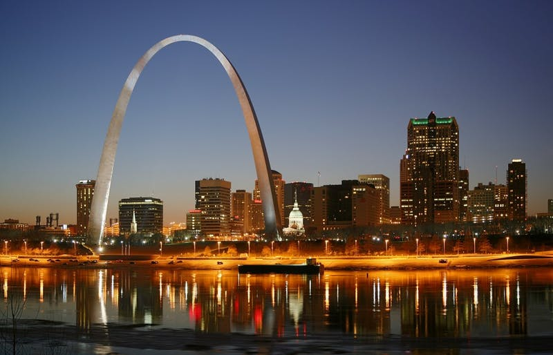 The Gateway Arch as seen in St. Louis, Missouri on the Mississippi river by night.