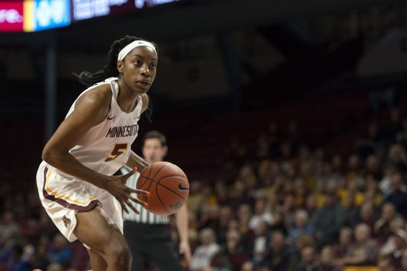 Junior Taiye Bello dribbles around the defender at Williams Arena on Tuesday, Nov. 20. The Gophers beat the Arkansas-Pine Bluff Golden Lions 84-42.