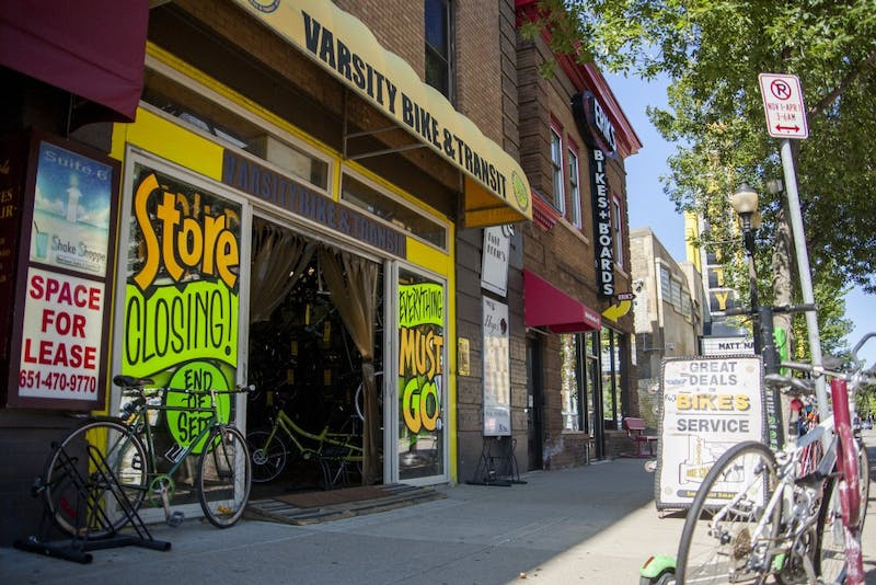 Signs advertise store closing sales at Varsity Bike and Transit on Thursday Aug. 29.  The Dinkytown business is set to close at the end of September.