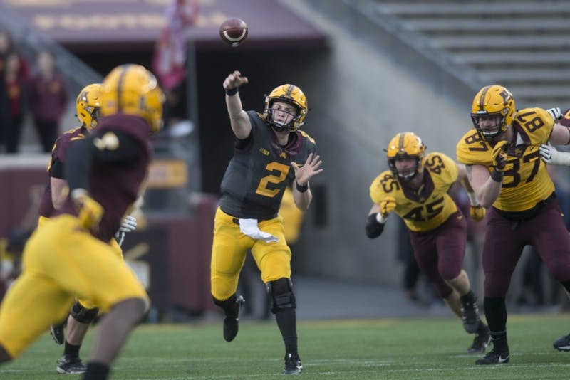 Quarterback Tanner Morgan throws the ball during the Gophers football spring game at TCF Bank Stadium on Thursday, April 12.