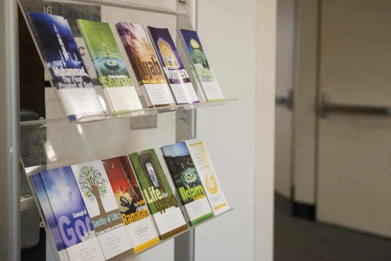 Brochures about the Islamic faith sit on a shelf inside Coffman Union on Monday, Oct. 21.