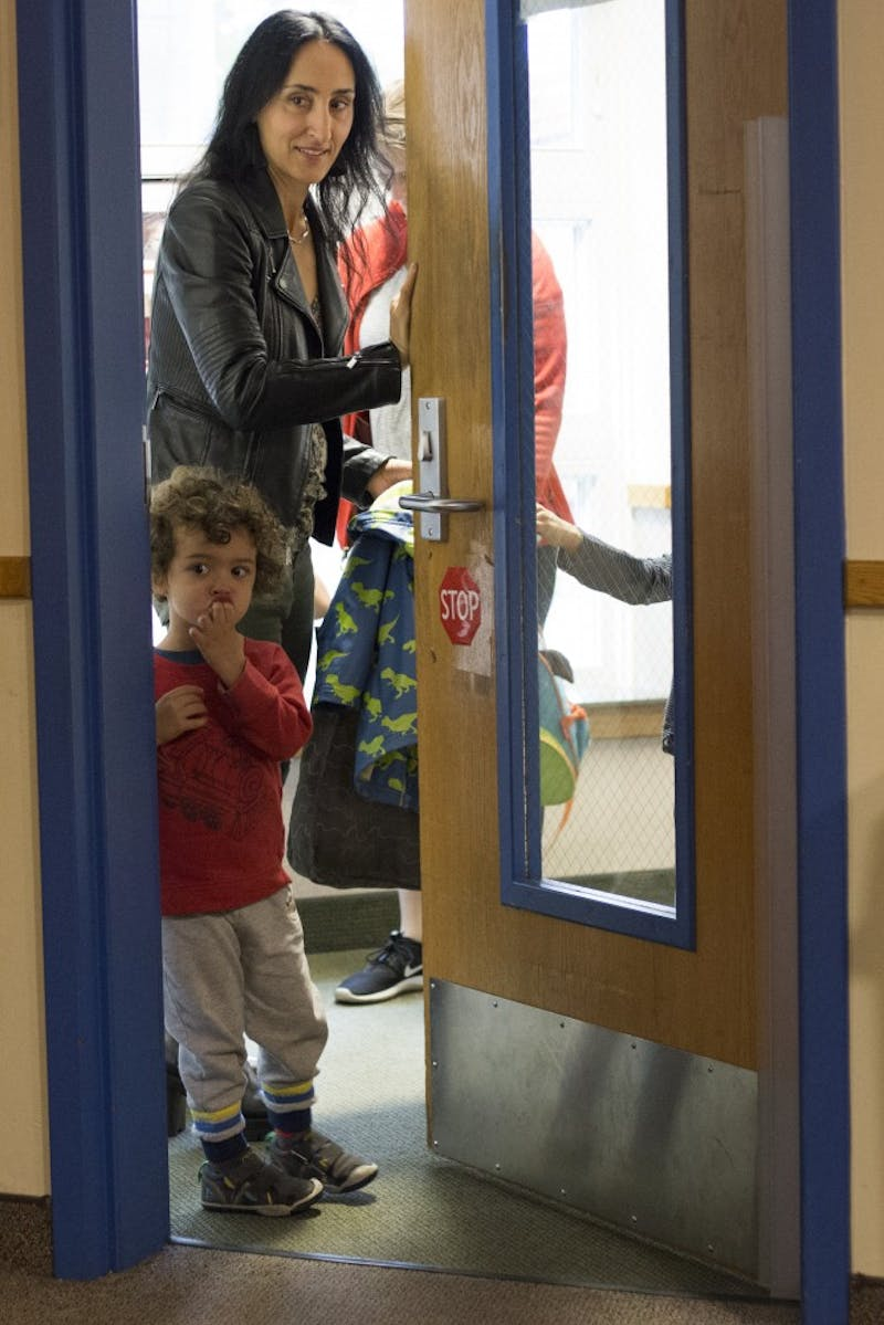 Associate Professor of Veterinary Clinical Sciences Antonella Borgatti drops off her sons Leonardo and Lorenzo Everest at the University of Minnesota Child Development Center on Wednesday, Oct. 3 in Minneapolis. She drops her boys off every morning before going to work on campus.