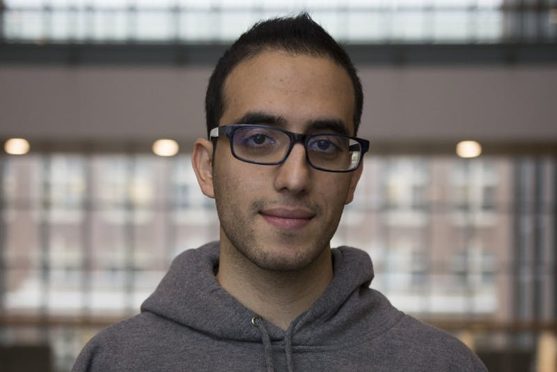 Sina Shirinpour, a Ph.D. Candidate in the Department of Biomedical Engineering, poses for a portrait inside Nils Hasselmo Hall on Wednesday, Dec. 13. Originally from Tehran, Iran, his residence in the U.S. is affected by the Supreme Court's ruling of the new travel travel ban.