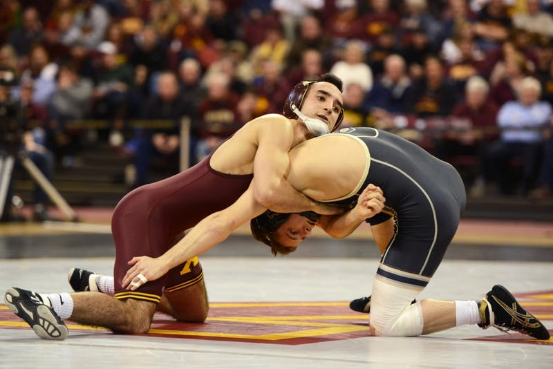 Ben Morgan contends against Purdue wrestler Luke Welch in the 133-pound weight class matchup at the Sports Pavilion on Sunday.