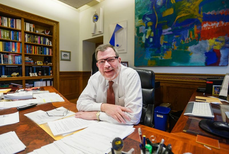 University president Eric Kaler discusses the hockey riots, new light rail and his summer plans in his office in Morrill Hall, Monday.