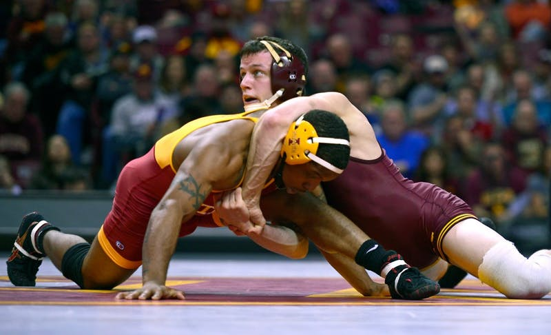 Junior Brandon Kingsley pins an Iowa State opponent Renaldo Rodriguez-Spencer Friday night at Williams Arena. Kingsley made one of two pins for the team's 30-10 victory.
