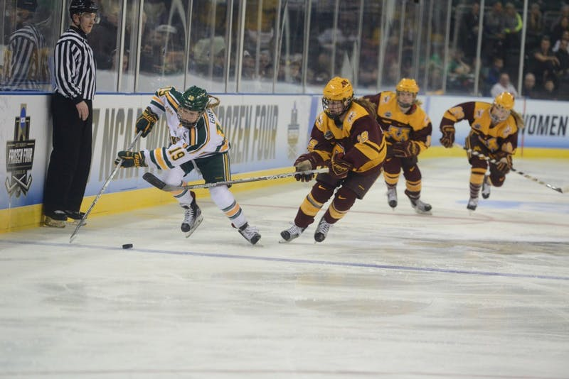 Sophomore forward Loren Gabel handles the puck on Friday, Mar. 17, 2017 in St. Charles, Missouri at the Family Arena. The Gophers lost 4-3 against Clarkson University Golden Knights.