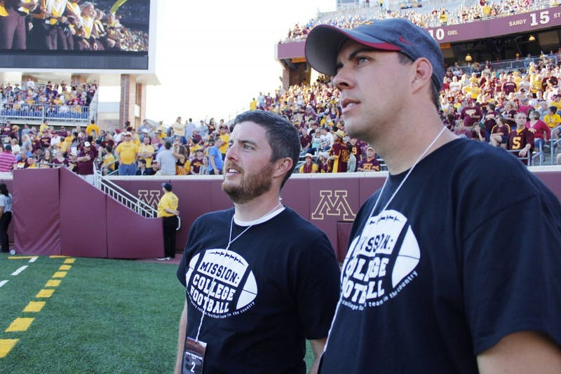Mike Fulton and Seth Vander Tuig watch from the sidelines as the Gophers take on Middle Tennessee at TCF Bank Stadium on Saturday.