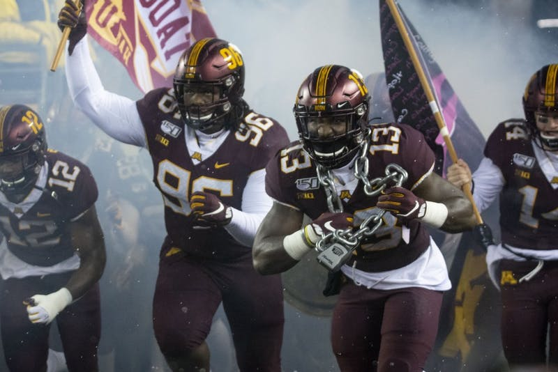 The Gophers run onto the field to play the Nebraska Cornuskers at TCF Bank Stadium on Saturday, Oct. 12.