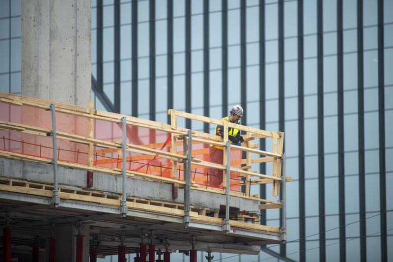 Construction is conducted in Minneapolis on Monday, April 6. Many developments could be put on hold as policymakers try to decrease COVID-19's spread.