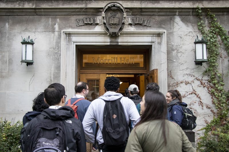 A group of graduate students enters Morrill Hall on Thursday, Oct. 10 to petition the change in their University sponsored health plans.