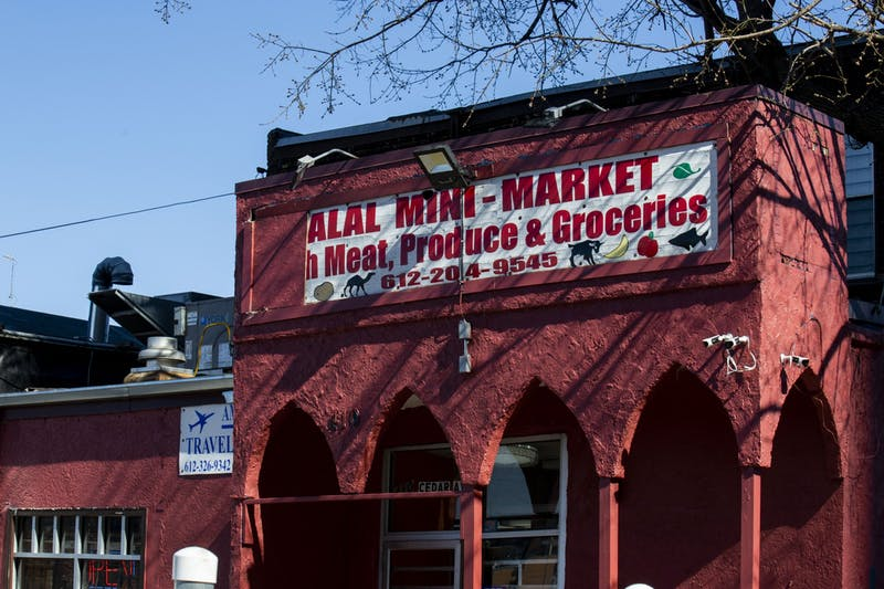 Halal Mini Market, one local business that is limiting the number of customers that come into the store at a time, is seen on West Bank on Monday, March 31.