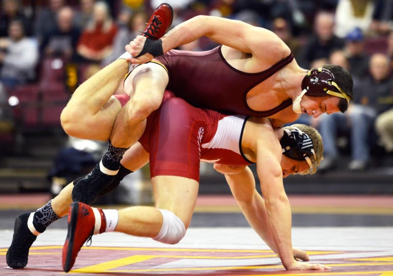 Brandon Kingsley contends against Indiana wrestler Jake Danishek in the 157-pound weight class matchup at the Sports Pavilion on Friday.